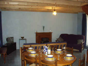 Living area with table set for 6 people.